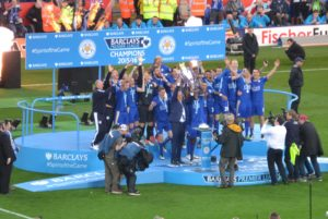 By Peter Woodentop (LCFC lift the Premier League Trophy) [CC BY-SA 2.0 (http://creativecommons.org/licenses/by-sa/2.0)], via Wikimedia Commons